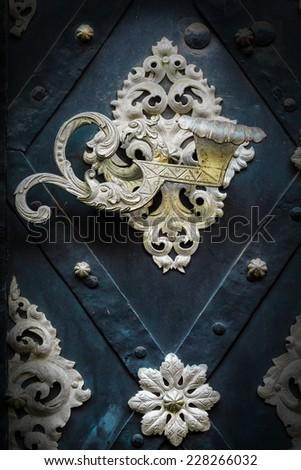 metal decorated door with handle as figure - stock photo