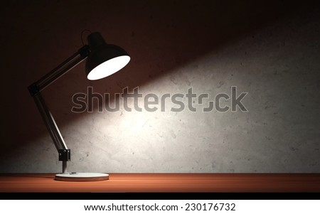Metal Desk Lamp at Night on the Wooden Table - stock photo