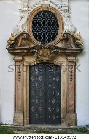 metal door to the monastery - stock photo