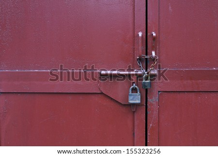 metal door with lock in grungy style and good texture. - stock photo