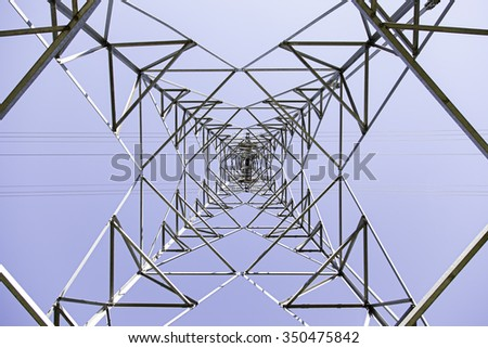 Metal electrical tower, detail of an installation of electric transport - stock photo