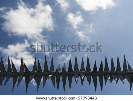 metal fence against blue sky
