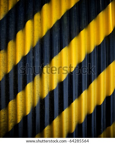 metal fence with warning stripe - stock photo