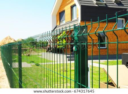 Metal fencing modern house outdoor metal stock photo image metal fencing with modern house outdoor metal fence design workwithnaturefo