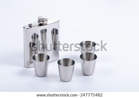 metal flask with metal pint cups for alcohol