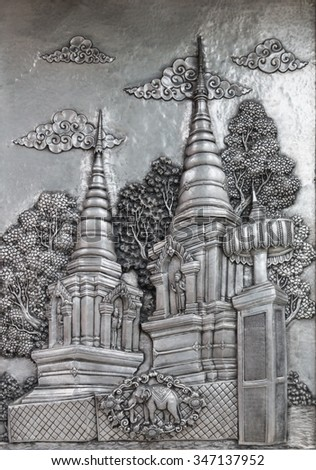 Metal foil handicraft with folk art in temple of Thailand (Wat muensarn; They are public domain or treasure of Buddhism, no restrict in copy or use)