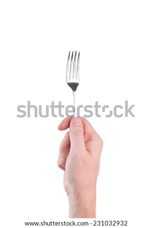 metal fork in a human hand isolated on white background - stock photo