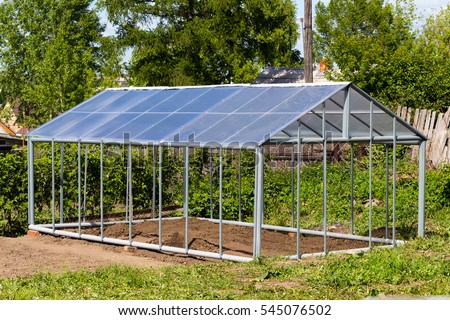 Metal frame greenhouses with a gable roof