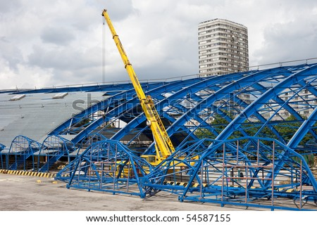 metal frame structure on deconstruction site of a shopping mall building
