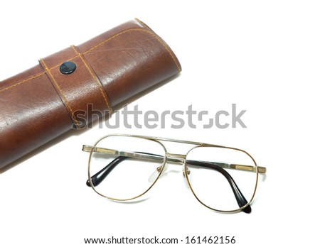 metal-framed glasses and glasses box isolated - stock photo