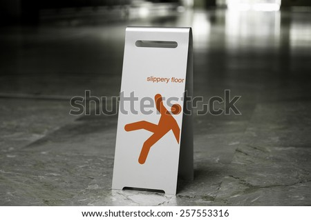 Metal free standing sign slippery floor on a marble floor - stock photo