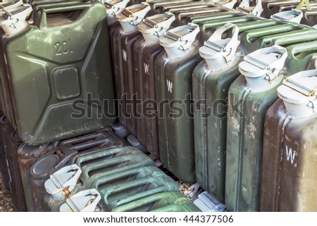 metal fuel tank or jerry can for transporting and storing gasoline or diesel fuel store, can use motor oil or fuel concept background - stock photo