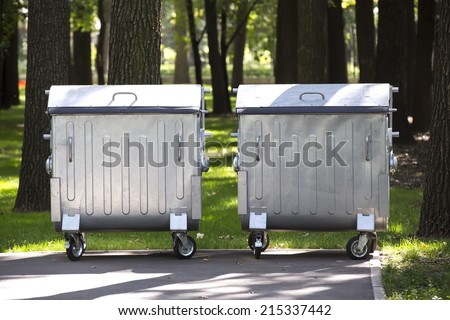 metal garbage cans in the green garden - stock photo