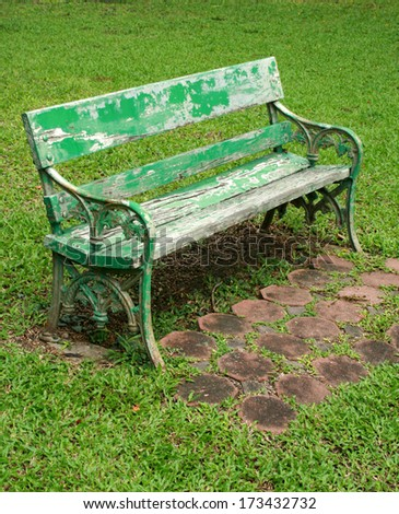 metal garden chair on green grass