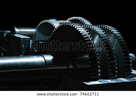 Metal gears on black background - stock photo