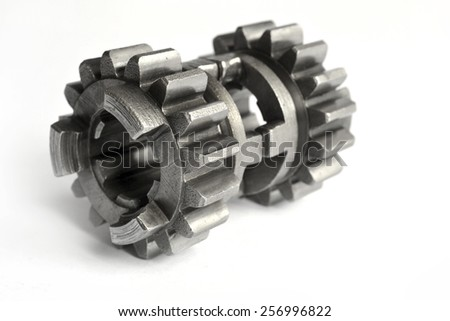 Metal gears on the white background. - stock photo