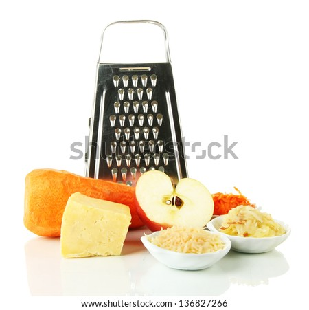 Metal grater and apple, cheese, carrot,  isolated on white - stock photo
