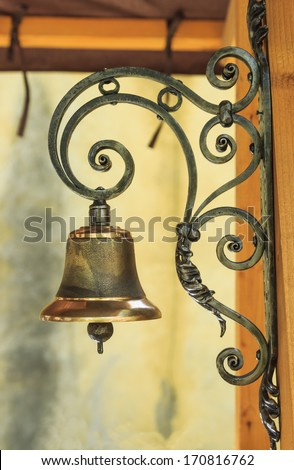 Metal grid and iron bell - stock photo