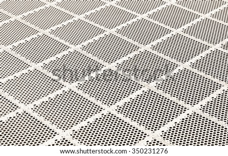 Metal grid background. Sepia metal grate. Steel mesh floor.
