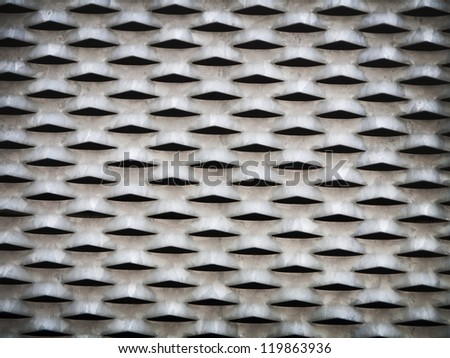 metal grid pattern with holes