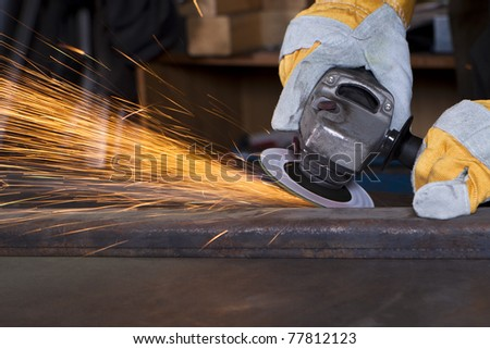 metal grinding with orange flying sparks - stock photo
