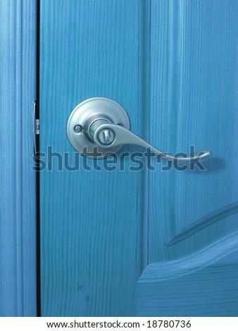 metal handle closeup and door blue toned - stock photo
