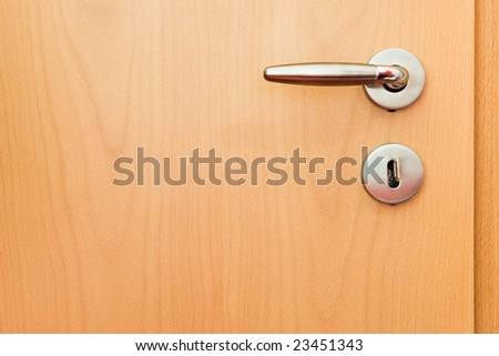 metal handle on wooden door
