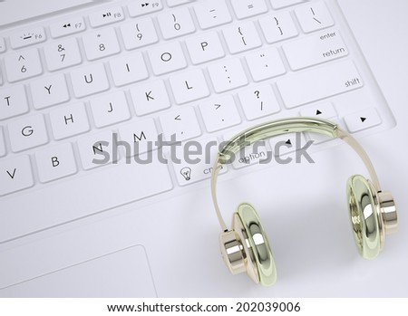 Metal headphones on the keyboard. View from above