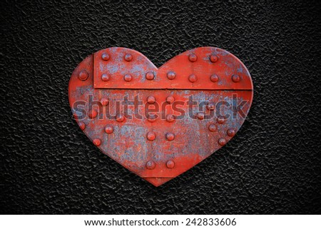 Metal heart on a dark concrete texture - stock photo