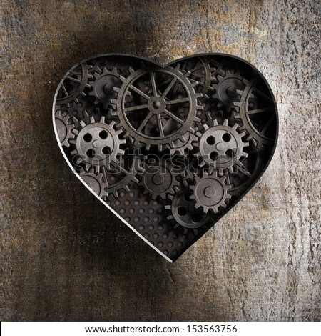 metal heart with rusty gears and cogs - stock photo