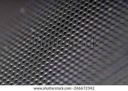 metal hole background (Closeup of speaker) - stock photo