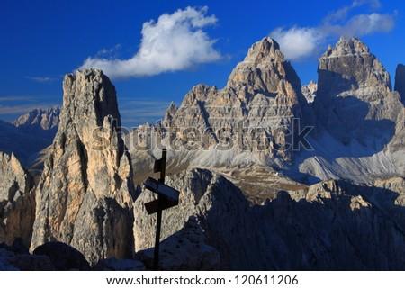 Metal indicator, Cadini di Misurina and Tre Cime di Lavaredo with Auronzo hut in the background, Dolomite Alps, Italy - stock photo