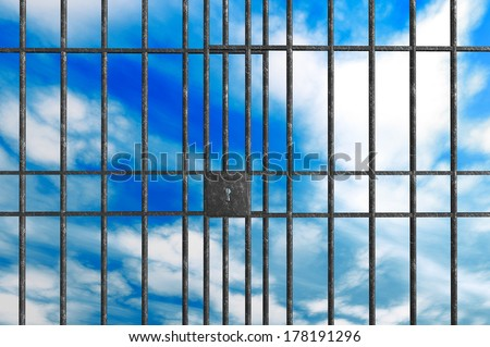 Metal Jail bars on a sky background - stock photo