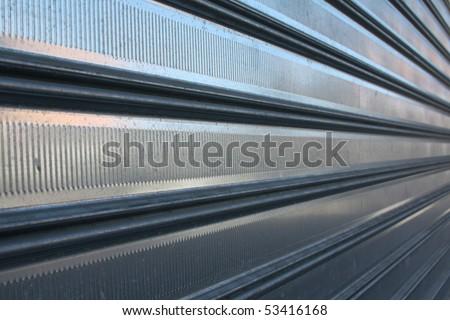 metal jalousie automatic door on the street - stock photo