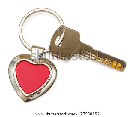 Metal key with red heart keychain. It is isolated on white background.