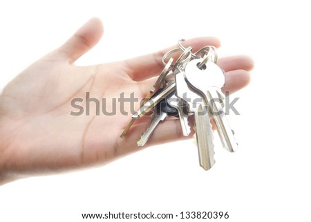 metal keys in woman hand isolated on the white background. - stock photo