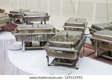 metal kitchen equipments on the table for fine wedding dining or another catered event
