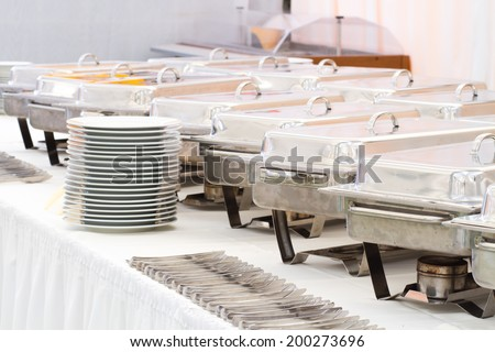 metal kitchen equipments on the table for fine wedding dining or another catered event - stock photo