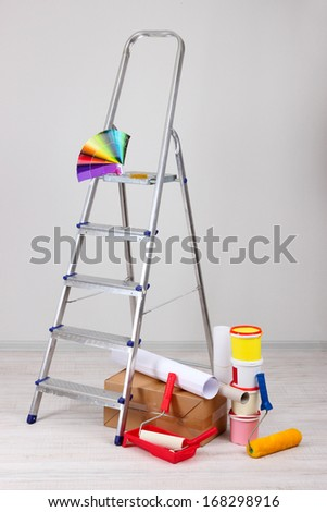 Metal ladder and paint in room