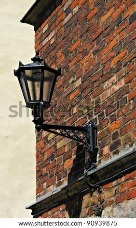 Metal lantern in old town - stock photo