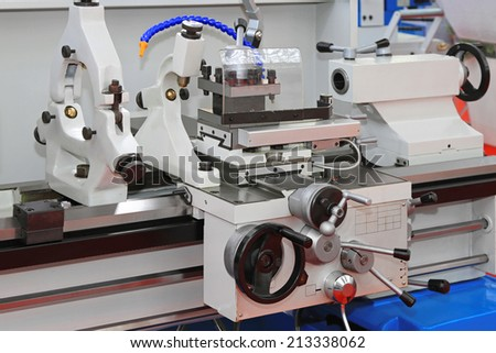 Metal lathe machinery tool equipment in workshop - stock photo