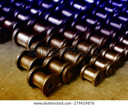 Metal link chains arranged in rows on the table