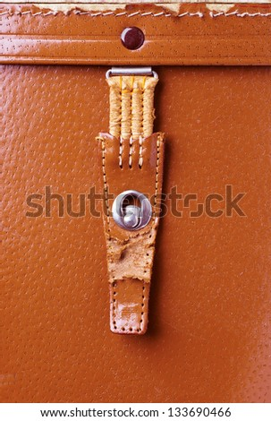 metal lock old red leather briefcase closeup - stock photo