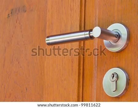 Metal lock on wooden door close up - stock photo