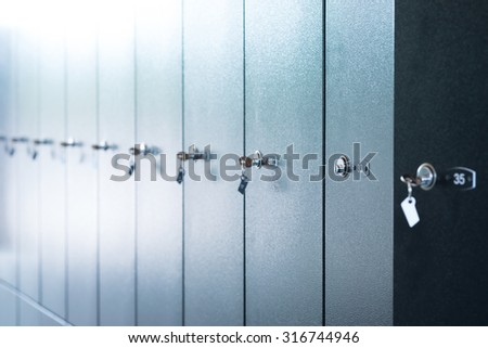 Metal lockers with keys and numbers, close up view - stock photo