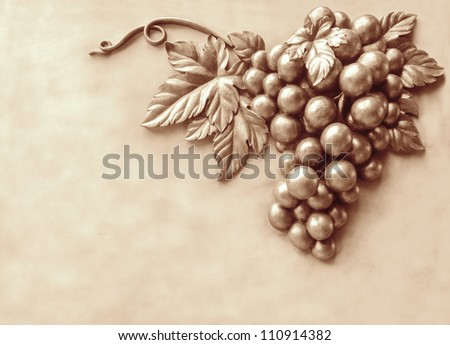Metal look grape on the wall. can be use for background color changed - stock photo