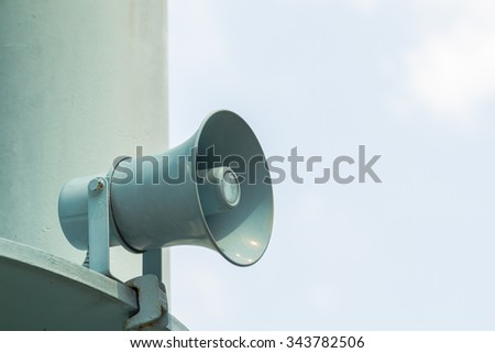 Metal loudspeakers on building for information. - stock photo