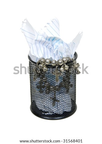 Metal mesh garbage container for rubbish and discarded items holding a silver cross trinket of value - path included