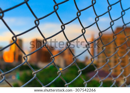 Metal mesh with blur background and blue sky