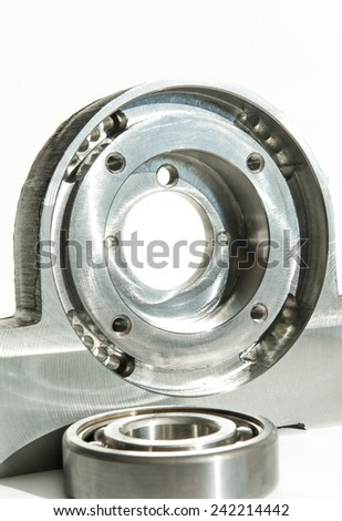 Metal mounted roller bearing unit CNC technology. Milling lathe and drilling industry. Metalworking. Mechanical engineering. Indoors closeup. - stock photo
